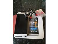 HTC One M7 used and unlocked.In pristine condition