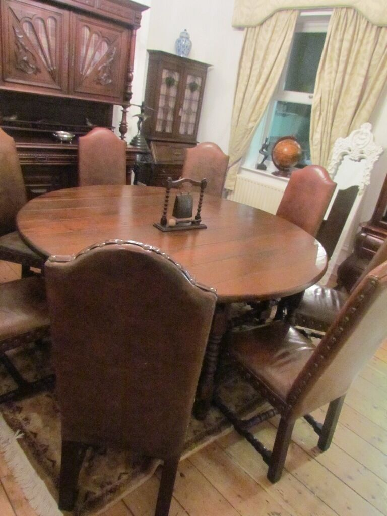 rare huge medieval style dining room table & 8 studded high back