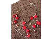 Red multi string necklace