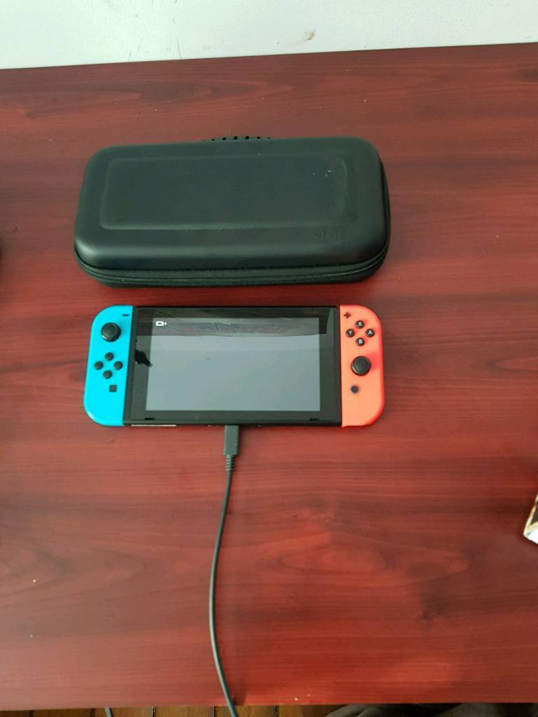 Nintendo Switch Neon Red/Blue joy-con unboxed but with case (No games)