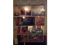 Beautiful lit 8 room, fully furnished Victorian style dolls house. Ideal gift to look at and love