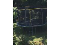 Large 12ft trampoline w/safety net and ladder