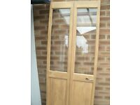 Pine half glazed folding door