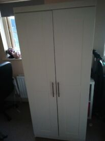 White wardrobe with silver handles