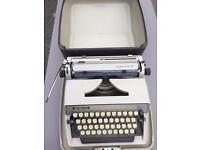 ADLER Gabriele 25 typewriter with potable case in immaculate condition.