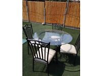 GLASS DINING TABLE WITH 4 CREAM LEATHER CHAIRS