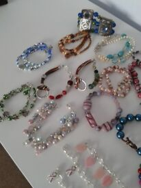 This is a lot of 30 bracelets all hand made. There is a mix of stretch, some with magnetic clasps.