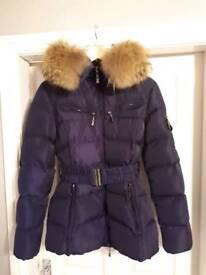 Racoon fur belted jacket