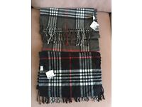 Various scarves for sale, some brand new with labels still attached
