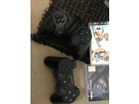 PS3 with two controllers and 12 games