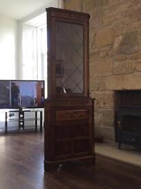 Oak finish corner unit with Leaded glass door