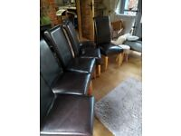 Six faux brown leather dining chairs