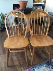Pair of oak finish Windsor style dining chairs