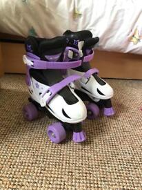Girls roller skates size 33-36. (Excellent condition)