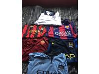 Various men's football shirts