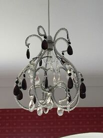 2 x black and clear chandeliers.