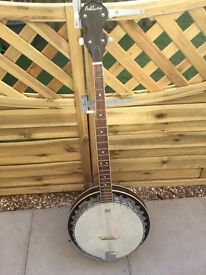 Ashbury Banjo. Slight crack to the neck with strings missing.