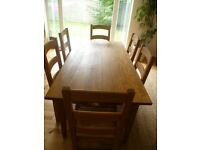 Solid Oak Dining Table and six ladder back oak chairs