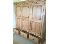 Solid pine heavy duty wardrobe, 3 doors, 3 drawers.
