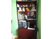 Brown cupboard cum book shelf in very good condition