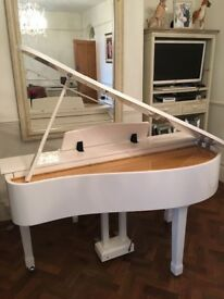 White baby grand digital piano