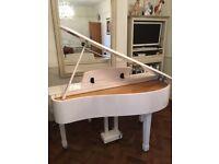 White baby grand digital piano