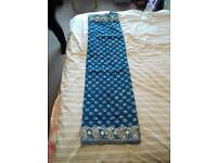 Deep turquoise saree with heavy embroidery and blouse
