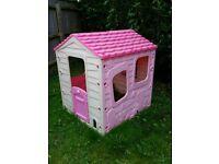 Pink plastic playhouse