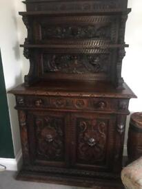 It's 19th century heavily carved oak cabinet. Antique beautiful quality carving