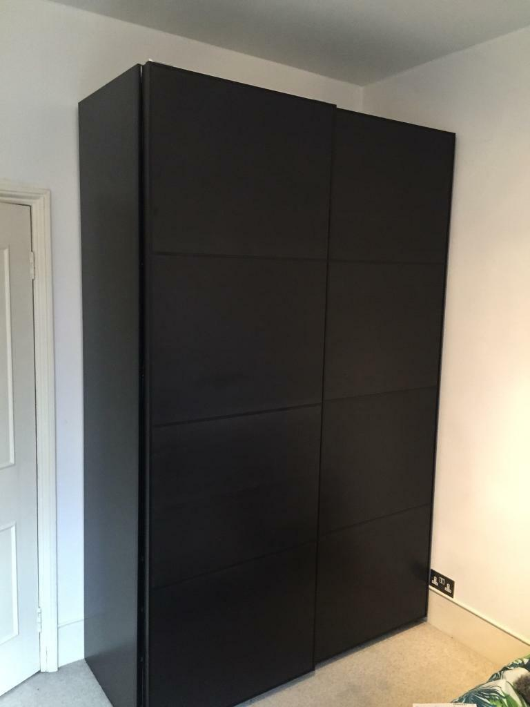 ikea pax wardrobe sliding doors black brown in. Black Bedroom Furniture Sets. Home Design Ideas