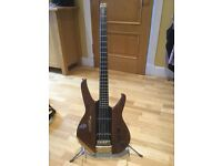 Washburn Status 1000 headless bass guitar with spare sets of double ball ended strings.
