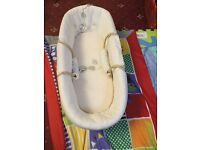 Winnie the Pooh Moses basket,lovely item,my baby out grew it too fast.from a smoke and pet free home