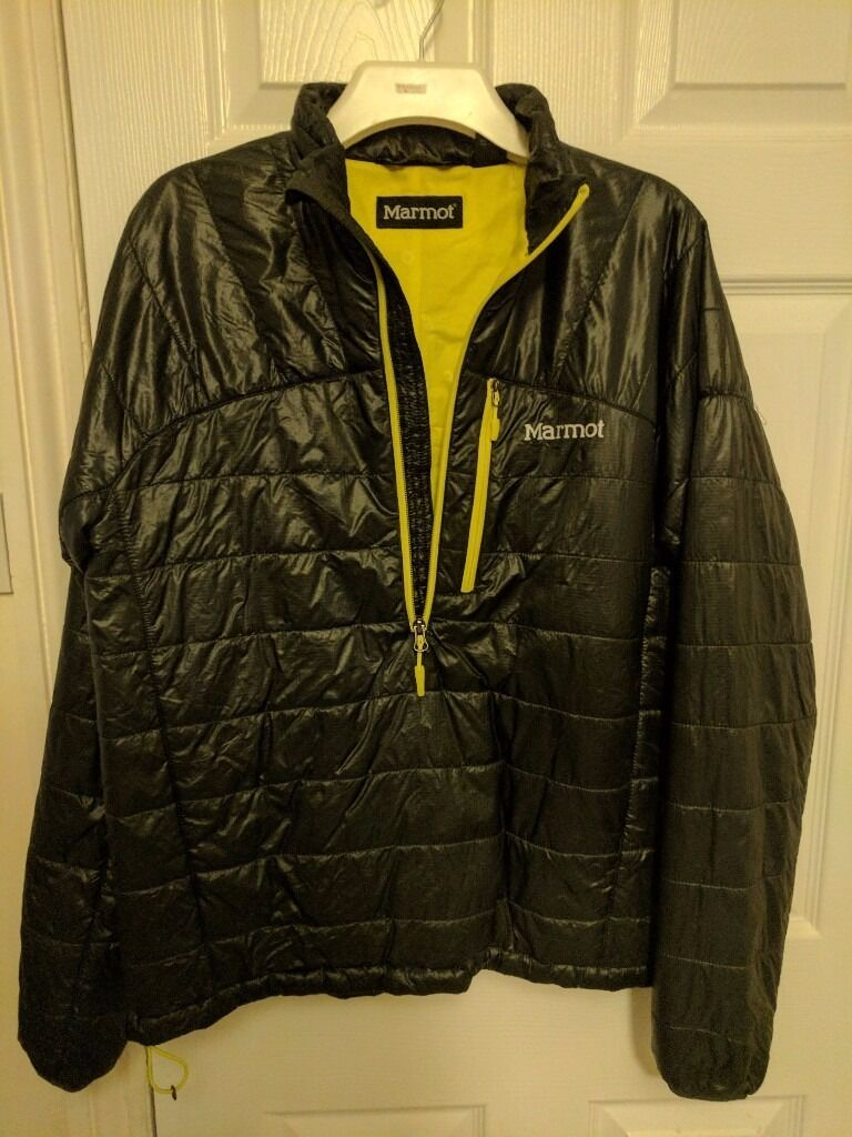 "Marmot insulating jacket (Mediumin Reading, BerkshireGumtree - Marmot synthetic fill pull over style jacket/mid layer. Jacket is windproof an water resistance, but not fully waterproof. This is the model without the hood. It folds up/stuffs into its own pocket. This isnt a thick ""Michelin man"" style puffa..."