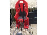 Red child's bike seat Easy to attach to any bike. Needs a clean. Cash on collection only.