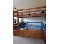 Wooden bunk beds with storage and mattress