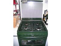 Cooker with gas hobs and grill and electric fan assisted oven. 60cm wide.
