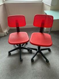 2x red office chairs
