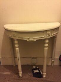 Ornate half table
