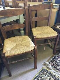 Lovely Pair Of Vintage oak chairs with rush seats vgc