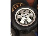 """Full set of Ford 15"""" alloy wheels with 195 60 15 tyres"""