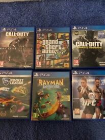 Black PS4 two controllers and games