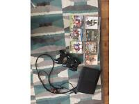 PS3 with 3 controllers + 7 games