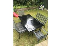 Large garden table with chairs and benches