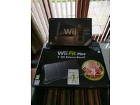 WII Fit and Wii sports and sports resort plus Wii fit balance board and fit games package