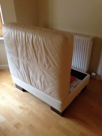 Large leather footstool with storage