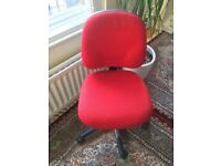 Red study/office chair on wheels