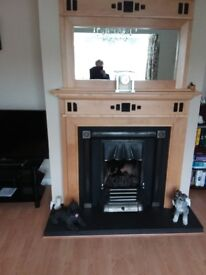Wooden 54 inch fireplce with mirror and gas inset.