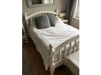 Double pine bed frame for sale. Painted white. Excellent condition.