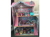 Dolls house with extra dolls and dolls furniture