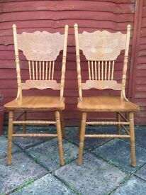 4 heavy oak dining room chairs